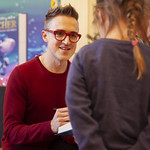 Tom Fletcher signs book for young fan: © Robin Mair |
