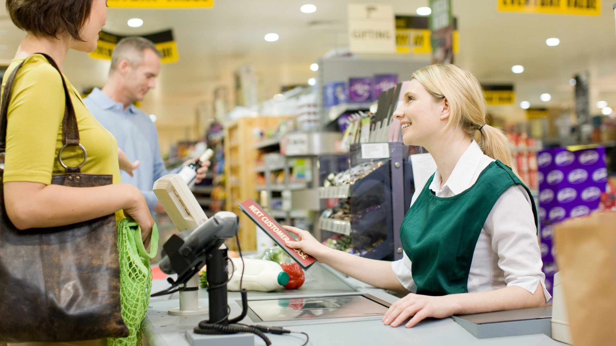 A cashier working at a checkout