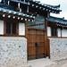 Stone wall, wooden door, tile roof