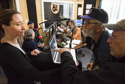 Carrie Booher shares some old photos at WWOZ's 39th birthday - Dec. 4, 2019. Photo by Ryan Hodgson-Rigsbee rhrphoto.com.