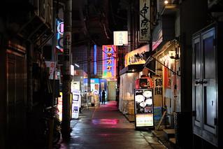 Pink Reflection within dark alley