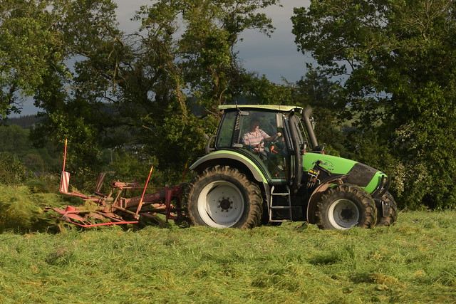 Deutz Fahr Agrotron 120 Tractor with a Lely Lotus Stabilo 6 Rotor Tedder