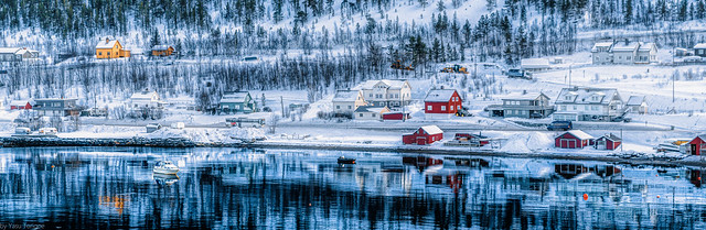 Icy waters and snow-covered beautiful homes along the edge of Alta Harbor, Norway-43a