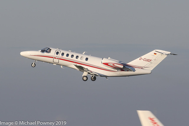 D-CUGF - 2015 build Cessna 525B Citation Jet CJ3, climbing on departure from Runway 23R at Manchester
