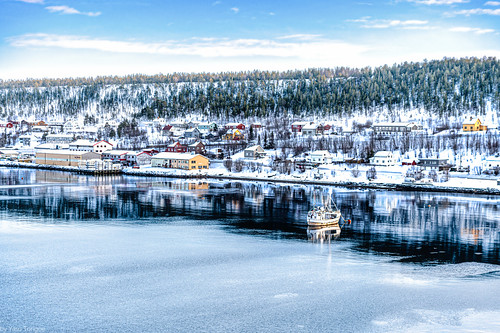 Icy waters and businesses and snow-covered homes along the edge of Alta Harbor, Norway-42a