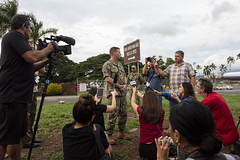 Rear Adm. Robert Chadwick speaks with news media outside Joint Base Pearl Harbor-Hickam, Dec. 4. (U.S. Navy/MC2 Charles Oki)