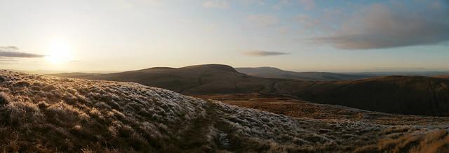 On the summit of Fan Nedd looking west towards Fan Gyhirych and Mynydd Du, sunset