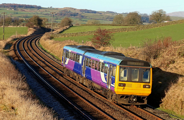 Northern Class 142 'Pacer' No 142049 passes Tommy Hall's Barn, Long Preston on 29.11.19 with 2Y60 1033 Morecambe to Leeds service