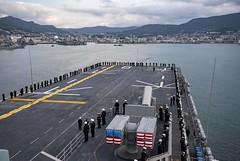 Sailors man the rails as USS America (LHA 6) arrives at Fleet Activities Sasebo, Dec. 6. (U.S. Navy/MC3 Vincent E. Zline)