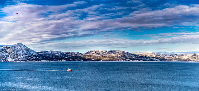 Helicopter, boat and mountains across the fjord from Alta, Norway-45aa