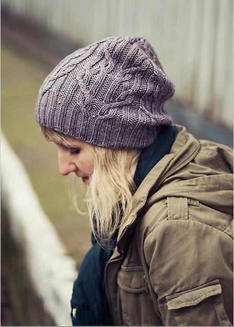 Justin's Lorkowska's Tied Knots hat is a free Ravelry download pattern! Not as quick a knit as a heavier weight hat but fun and cabled!