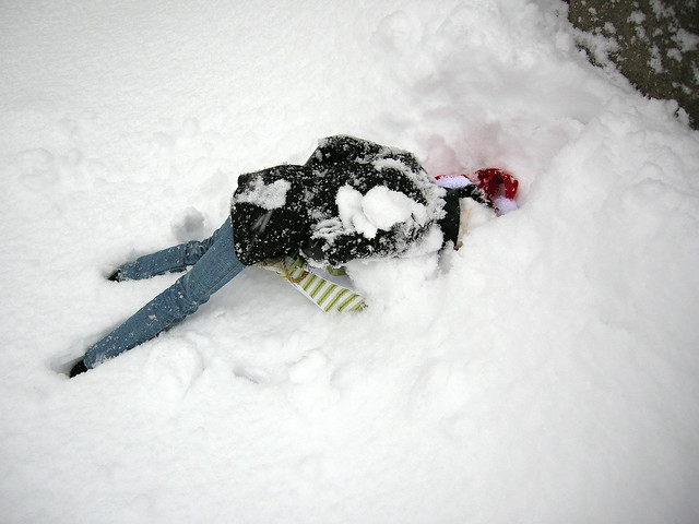 And then he slipped off the porch, down into the driveway.  The neighbors were surprised by me, in my jammies and down jacket, rescuing my doll in the driveway.  He was fine, thank goodness!  :>)