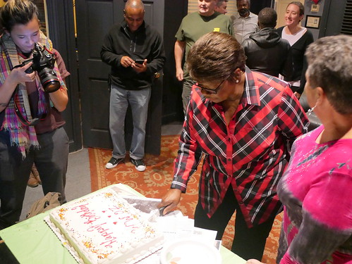 Irma Thomas cuts the cake at WWOZ's 39th birthday - Dec. 4, 2019. Photo by Louis Crispino.