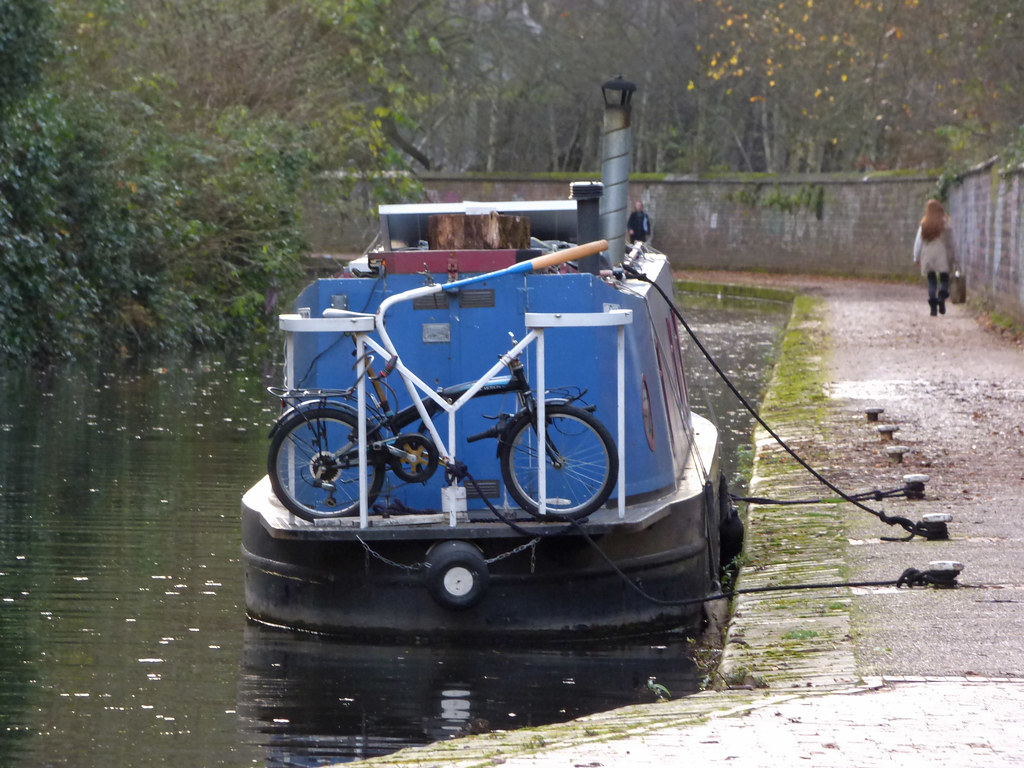 Bike on a blue narrowboat on the Worcester & Birmingham Canal