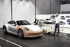 Designer Ben Baum at work on a clay model of the Porsche 992 while exterior design director Thomas Stopka looks on. Photo via @ben.baum #porsche #porsche992 #cardesigner #clay #claymodel #claymodeling #cardesign #inthestudio #automotivedesign #vehicledesi