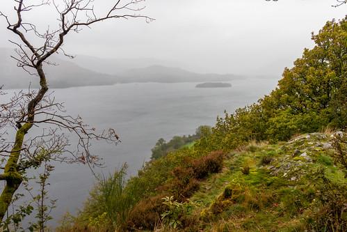 derwentwater lakedistrict nationalpark water lake mountain hill crag fell tree mist rain cloud landscape steep cumbria island hdr