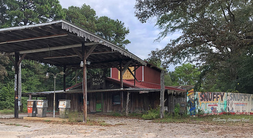 Snuffy Smif's.  A dilapidated store I spotted travelling Highway 98  thru Wilmer, AL.
