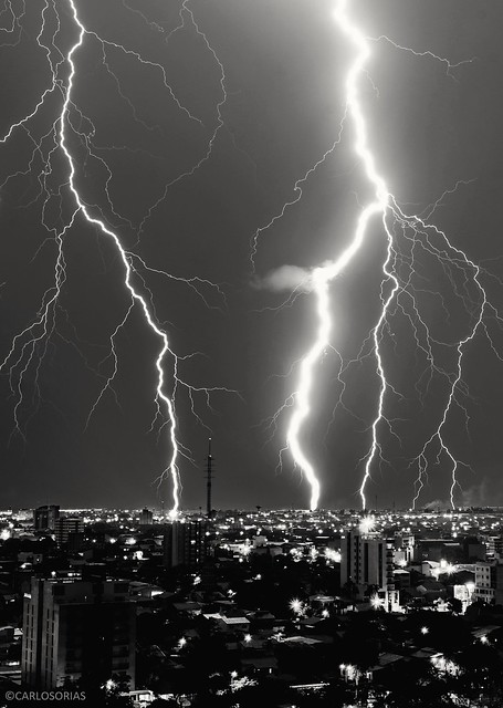 Bolts striking senses all at once, striking the city and the night.