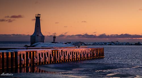 pier cobourgontariocanada lighthouse sunset beacon winter lakeontario ice aweartisticwomenofexception landscape