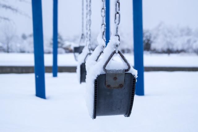 Swings Covered in Snow