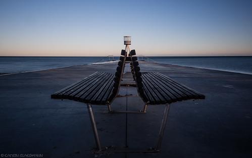 copenhagen klampenborg bellevuebeach denmark onthebeach baywatch sunset bench leading lines longexposure arnejacobsen lifeguardtower 1930s