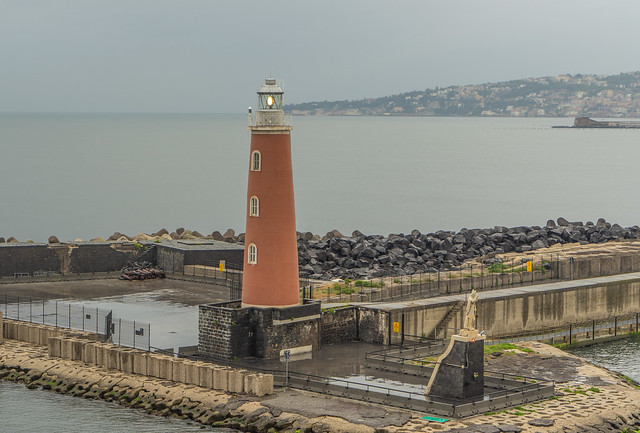 Lighthouse and San Gennaro, the patron saint of Naples.