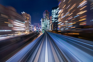 Motion blur from Yurikamome Line, an automated guideway transit service moving between modern business buildings in Tokyo (Japan)