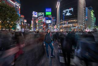 Francesca crossing at Shibuya district in Tokyo. Shibuya crossing is the busiest crosswalk in the world (Japan).