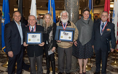 "After a moving ceremony at the State Legislative Office Building Friday night, State Representatives Tony D'Amelio (R-71) and Stephanie Cummings (R-74) offered their congratulations to 10 veterans, including four Waterbury veterans, on their induction into the 2019 class of the Connecticut State Veterans Hall of Fame.  According to the Connecticut Veterans Hall of Fame website, the honor ""was established to increase the awareness of the lifetime contributions of Veterans after completion of honorable military service. The Connecticut Veterans Hall of Fame is not a military hall of fame; instead it seeks to recognize Veterans for their countless contributions to society after their service.""  ""I'm honored to recognize these men for their lifetime of dedication and service to their brothers and sisters in the armed forces, their community and the state of Connecticut,"" Rep. D'Amelio said. ""In Waterbury, we always know we can count on the veterans to step up and help no matter what needs to be done, and these men are always at the front of that line. Congratulations!""  ""Waterbury has a strong tradition of brave women and men stepping forward and serving in the military, and the men honored tonight embody that tradition in the greatest sense,"" Rep. Cummings said ""Each of these veterans earned our respect through selfless sacrifice and service and I was proud to be able to be recognize Mr. Cahill, Comeau, Sarlo and Shea for their lifelong commitment to service and community.  The 2019 class of the Connecticut State Veterans Hall of Fame includes 10 members from the Army, Navy, Air Force, U.S. Marine Corps and U. S. Coast Guard. According to the Hall of Fame Committee, veterans who served their country honorably during their military service, and who continue to serve their communities, state and nation after discharge are eligible.  The first class was inducted in 2005."