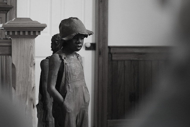 Whitney Plantation- sculpture in chapel of an enslaved child