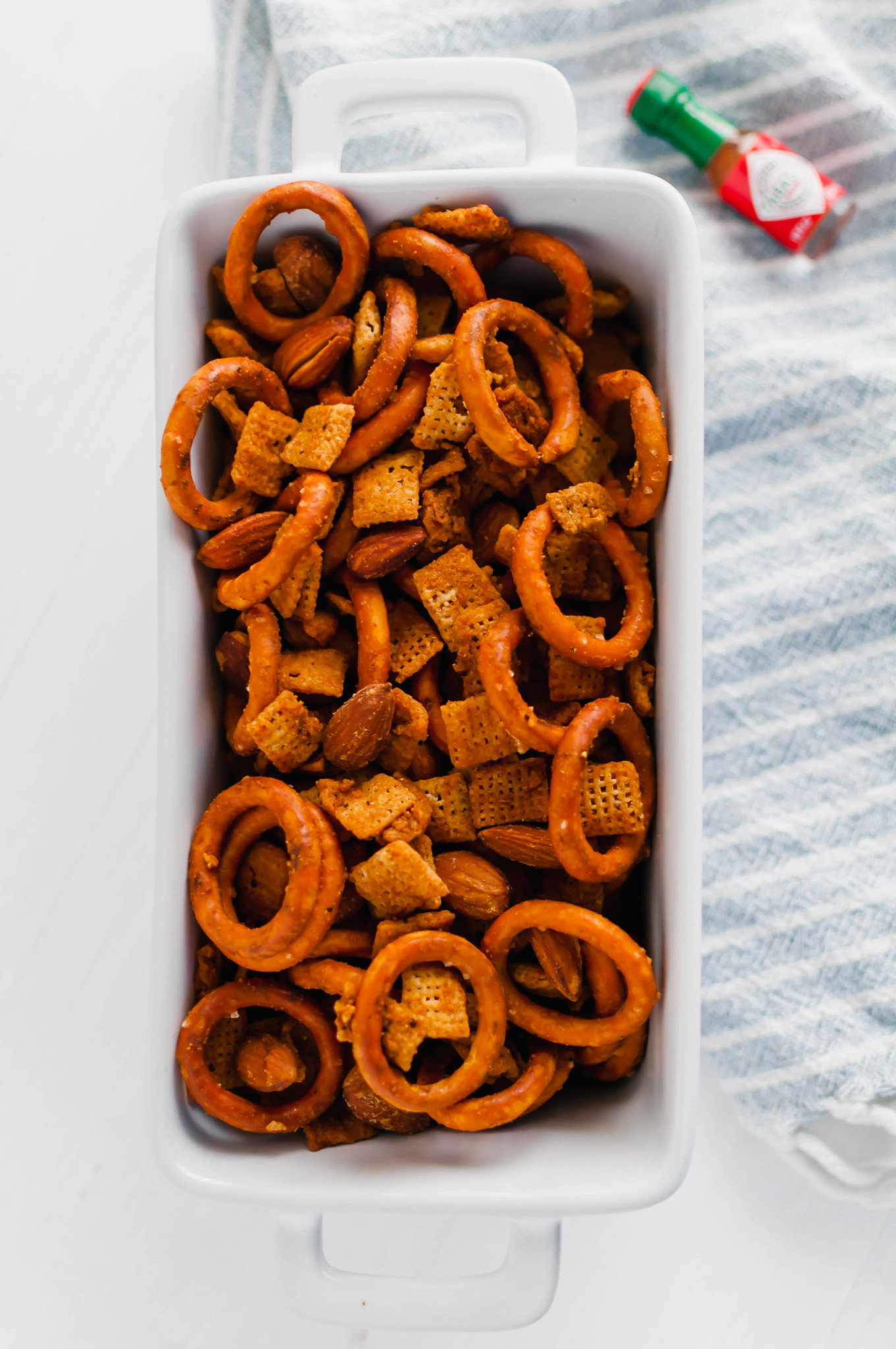 Need to add a little spice to your holidays? This Spicy Chex Mix is just what you need for snacking.
