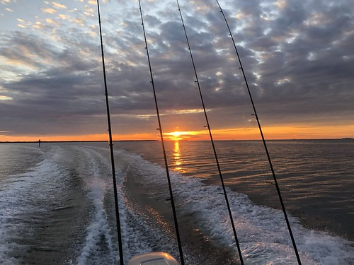 Photo of sunset over the Chesapeake Bay, from the back of a fishing boat.