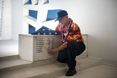 Edward Hoeschen, neighbor and caretaker of Lauren Bruner, looks at the newly unveiled name on the USS Arizona Memorial during an internment ceremony, Dec. 7. (U.S. Navy/MC2 Cole C. Pielop)