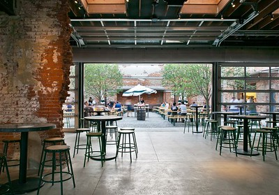 Restaurant/cafe with see through openable garage doors used to open the facade to the street