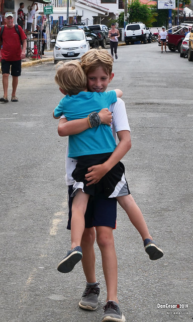 An Expression of Brotherly Love (At the completion of a 10k run the younger boy raises to greet his older brother)