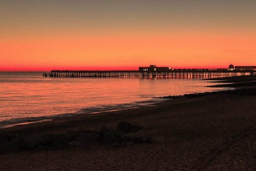 hastings east sussex pier sea beach seafront sun set sunset red sky orange