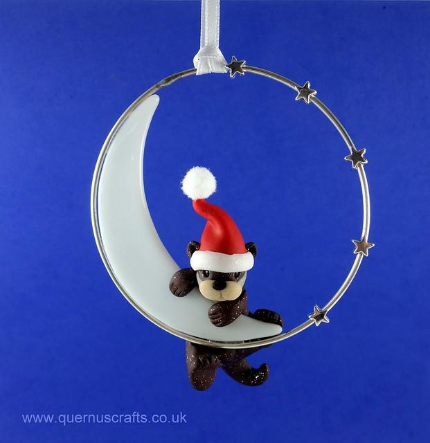 Little Sparkly Santa Otter on Glass Moon