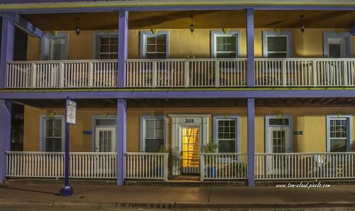 building architecture cityscape railing balcony windows door lightsnighttime nightshot downtown oldcoloradoinn stuart florida usa