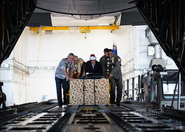 "Leadership make the ceremonial ""push"" of the first pallet to kick-off Operation Christmas Drop"
