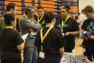 Judges from LANL  Jake Miner and James Owen listen to students from Taos Academy State Charter School as they explain their entry in the New Mexico Governor's STEM Challenge.