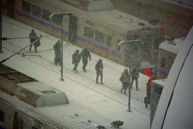 Deboarding:  Light Rail Train Passengers Arrive at Denver International Airport Station