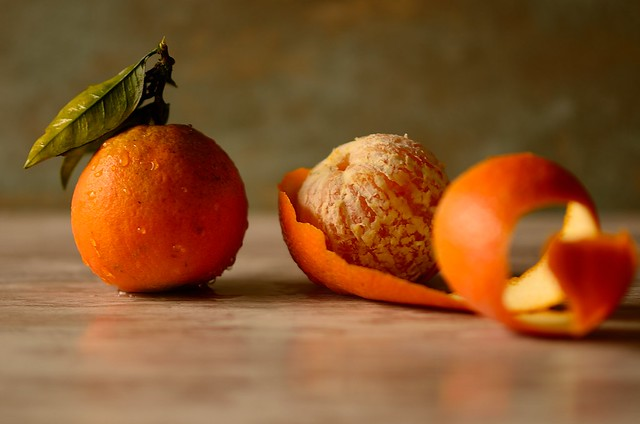 Two oranges under the window light on a rainy morning