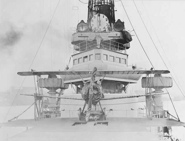 Sopwith Camel On the forward turret of USS TEXAS (BB-35) 1919. Note ship's bridge, rangefinder and range clock; anti-splinter mattresses atop cranes
