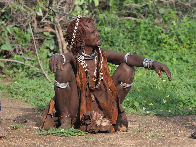 Elder Hamar woman wearing Esente necklaces and numerous iron rings called Zau on her arms and legs