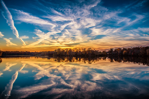 sunset lake reflection circles touch gentle lines sky ways drawing pattern picture depiction harmony save what you got see home keep peace compassion nikkor nikon outside water nature blue orange light clouds landscape magic photography open wide our treasure preserve guard