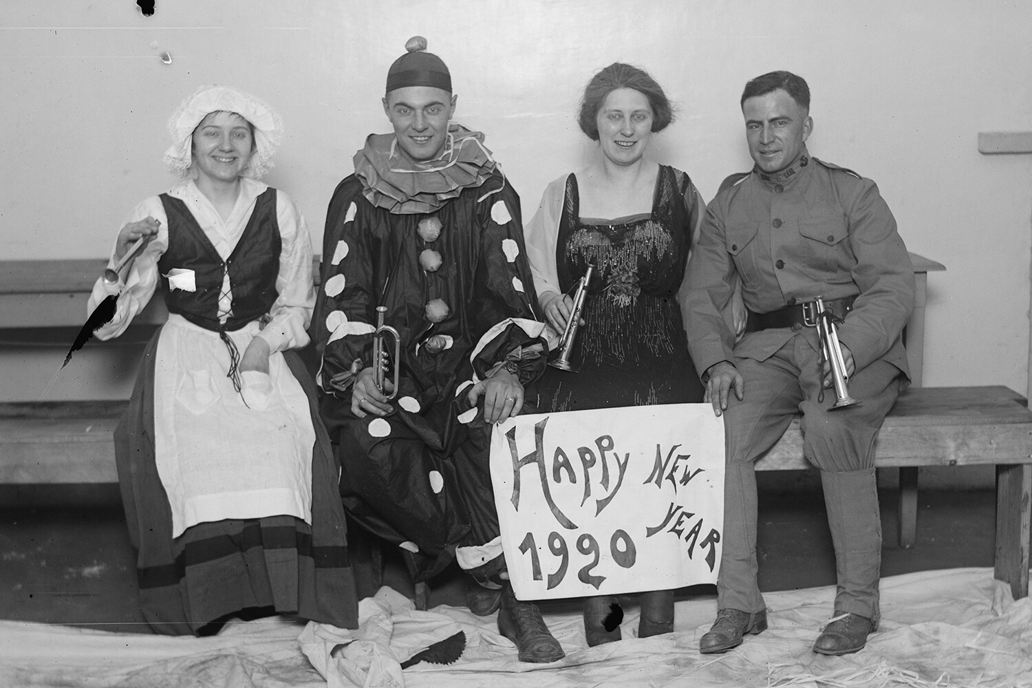 Image of costumed people celebrating the New Year, 1920.