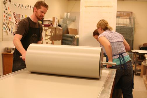 Brandon Gunn and Lea Friesen prepare the roller