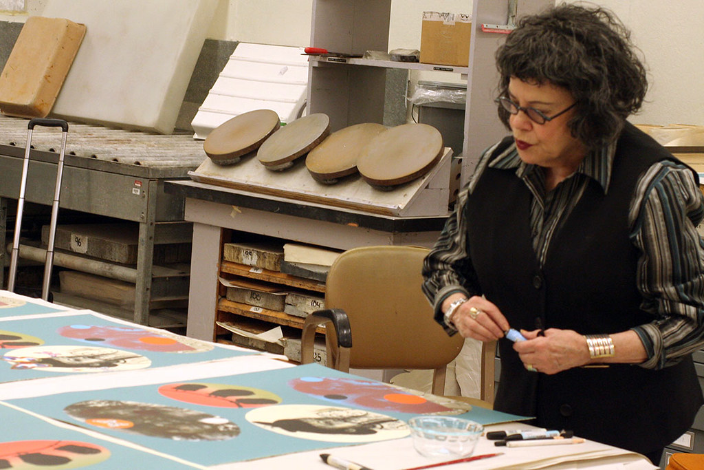 Phyllis Bramson reviewing prints