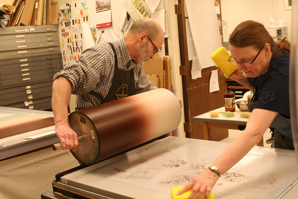 rolling ink and sponging at the litho press
