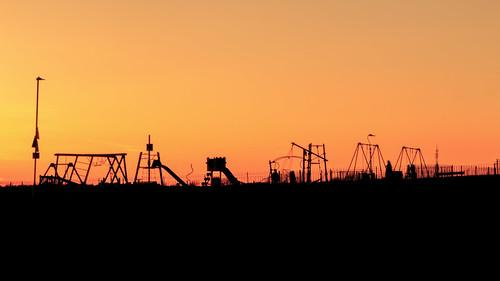 hastings east sussex playground swing slide sunset sun set orange sky